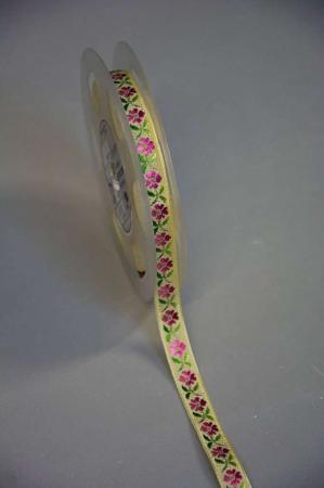 Gult pynte bånd med lyserøde blomster